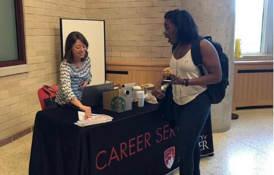 Student meeting Career Services rep