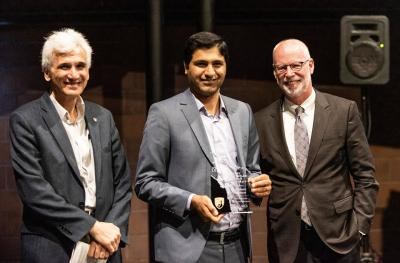 Mohesen Mahoor receiveing Award from Dean Holston and Dr. Ogmen