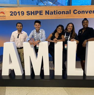 Elizabeth Gutierrez-Gutierrez with others at 2019 SHPE conference