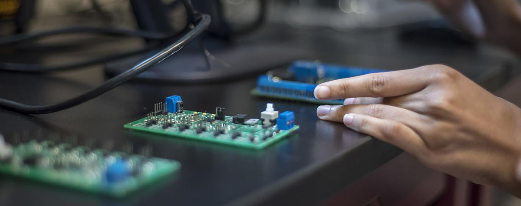 hand holding circuit boards